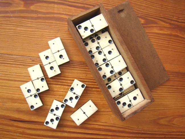 click to view larger image of A boxed set of Civil War period bone and ebony dominoes circa 1865