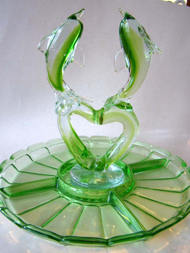 click to view larger image of An attractive vintage green depression glass serving dish with removable double dolphin centerpiece