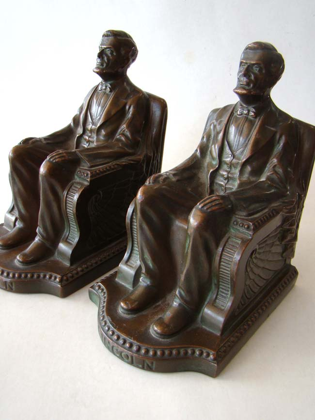 click to view larger image of A pair of Lincoln in the chair bookends by NUART circa 1924
