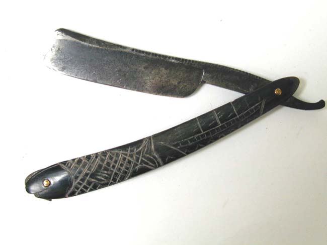 click to view larger image of A Charming 19th century Sailor-Made Scrimshawed Baleen Mounted Straight Razor circa 1860.