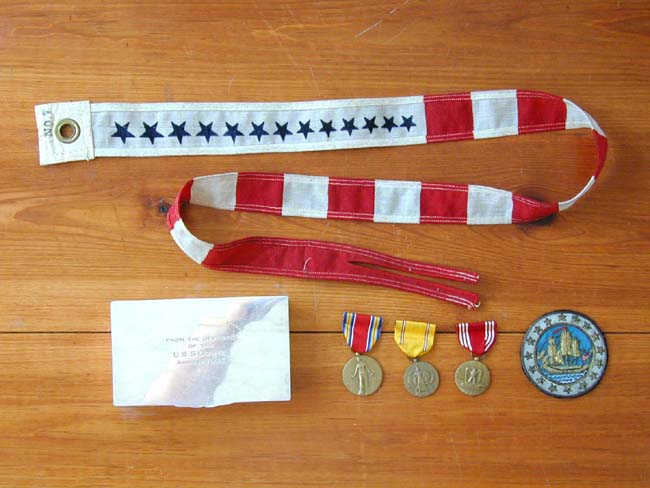 click to view larger image of The Commissioning Pennant and other Memorabilia from the U.S.S. Cowie circa 1942
