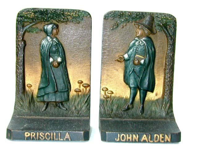 click to view larger image of A pair of Antique Bookends by Bradley & Hubbard depicting John Alden & Priscilla circa 1910