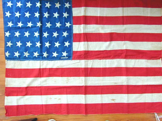 click to view larger image of A Fine 42 Star Flag in the 'Tumbling Star' formation circa 1890, now in an elegant gilt frame