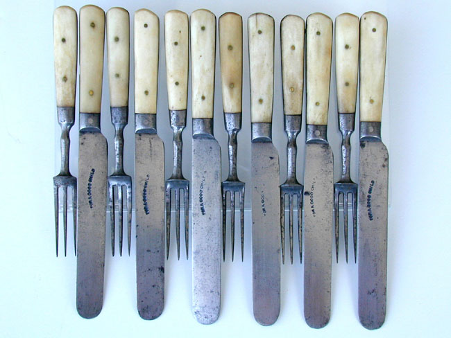 click to view larger image of A 19th century Set of Children's Bone Handled Forks and Knives stamped