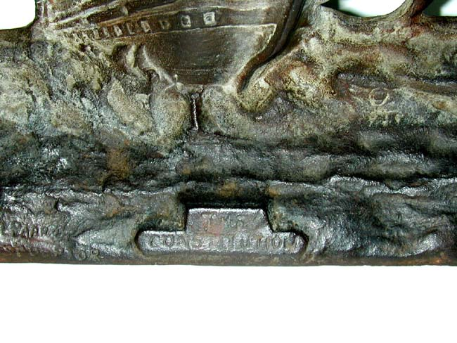 click to view larger image of Antique Cast Iron Doorstop of the U.S.Frigate Constitution Signed by the Sculptor