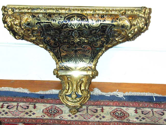 click to view larger image of An Antique french Louis XV Period Tortoiseshell and Gilt Brass Clock or Wall Bracket Circa 1715-1725