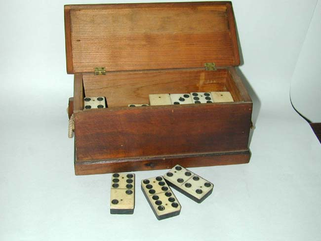 click to view larger image of A Fine Set of 19th century Bone and Ebony Dominoes housed in a Miniature Seamen's Chest