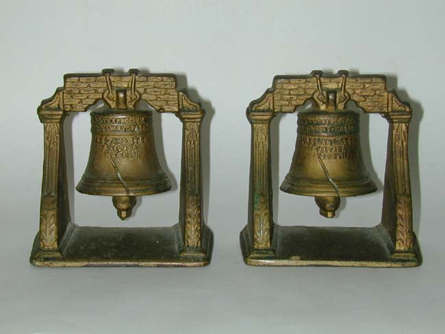 click to view larger image of An Antique Pair of 'Liberty Bell' Cast Iron Bookends circa 1910-1920
