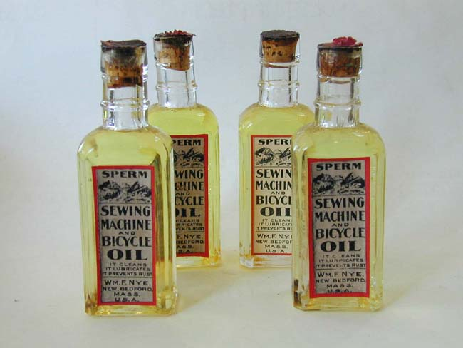 click to view larger image of Four RARE Unopened Bottles of late 19th century Sperm Whale Oil.