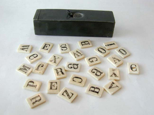 click to view larger image of A 19th Century Whalebone Alphabet Set in a 19th Century Pewter Apothecary Container.