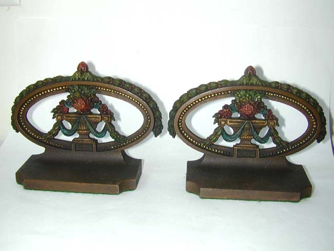 click to view larger image of A Pair of BRADLEY & HUBBARD Painted Flower Basket Bookends Circa 1900