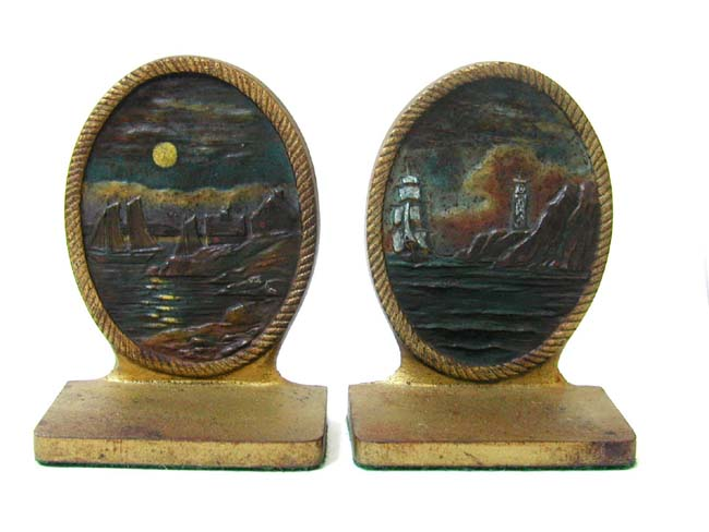 click to view larger image of A Pair of BRADLEY & HUBBARD Antique Bookends ca. 1910 depicting a Coastal Village in the Moonlight