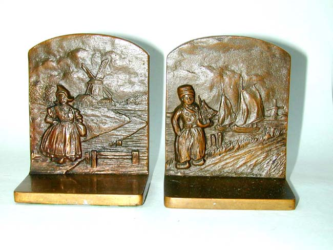 click to view larger image of A Pair of BRADLEY & HUBBARD Dutch Boy and Girl Bronze Antique Bookends circa 1920