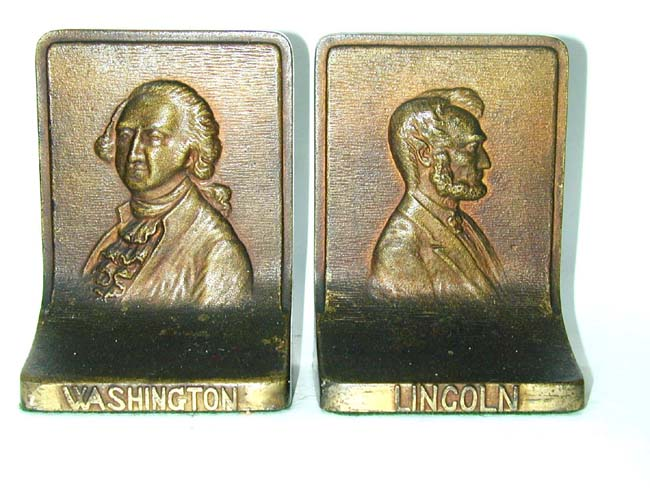click to view larger image of A Pair of BRADLEY & HUBBARD George Washington and Abraham Lincoln Antique Bookends circa 1910