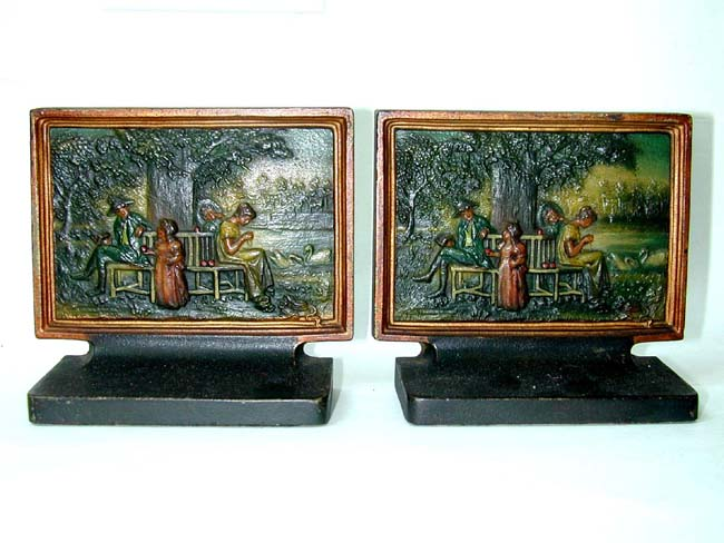click to view larger image of A Charming pair of Bradley & Hubbard Antique Bookends Depicting a Family Sitting Under a Tree