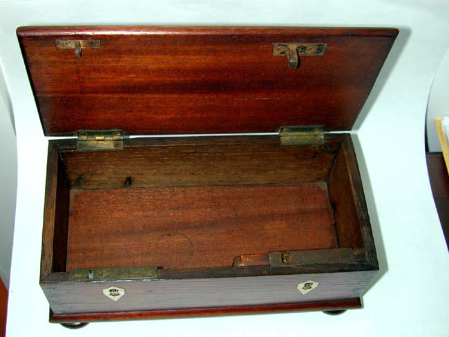 click to view larger image of A Small 19th Century Dovetailed Mahogany Box on Bun Feet with Ivory Key Escutcheons