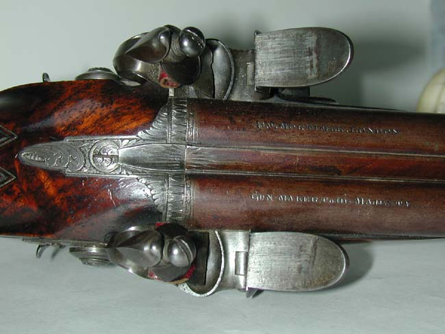 click to view larger image of An Exceptionally Fine Double-Barrelled Flintlock Carriage Pistol by 'H.W. Mortimer, Gun-Maker to His Majesty,' circa 1795