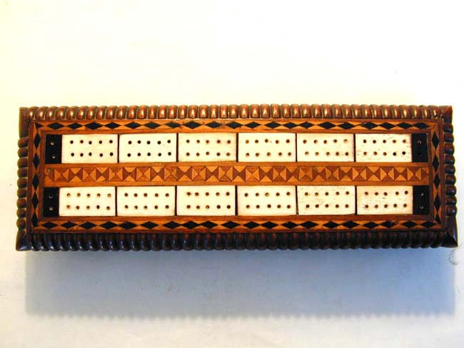 click to view larger image of An Attractive Antique Ivory Inlaid Walnut Cribbage Board with Four Ivory Markers circa 1875