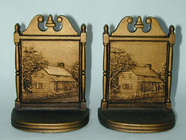 click to view larger image of A good pair of Antique Bookends by Bradley& Hubbard circa 1920 depicting a log cabin