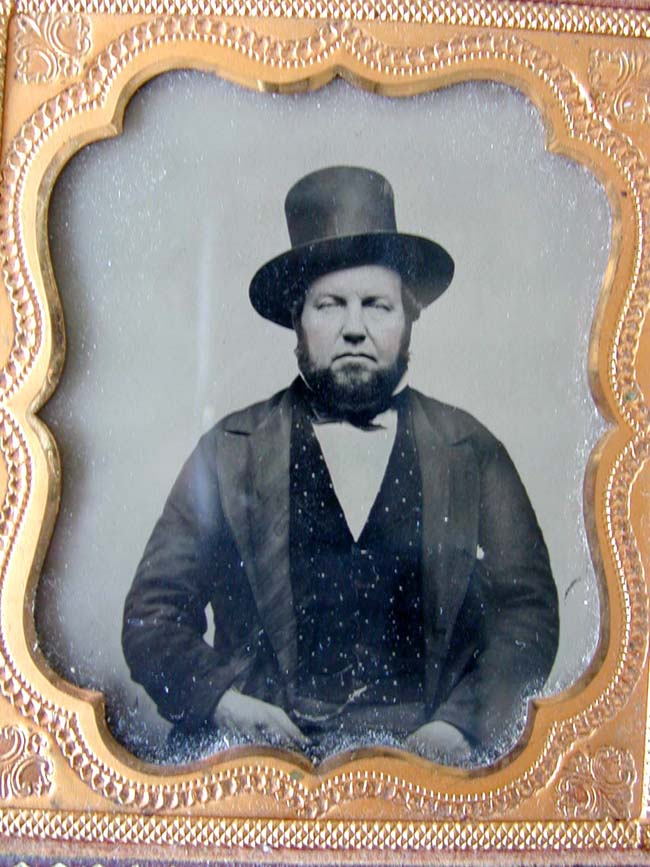 click to view larger image of A mid 19th century Ambrotype of a bearded Man wearing a hat circa 1850-1870