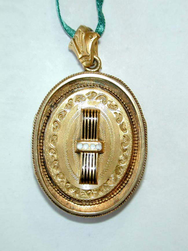 click to view larger image of A Victorian 14 kt. Gold Photo Locket accentuated with gold wire twist, beadwork and engraving.
