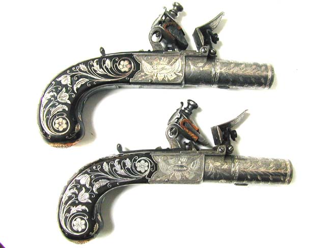 click to view larger image of A Museum Quality Pair of Flintlock Pocket Pistols inlaid with Gold and Silver by John George Lacy, London, circa 1810-1814.