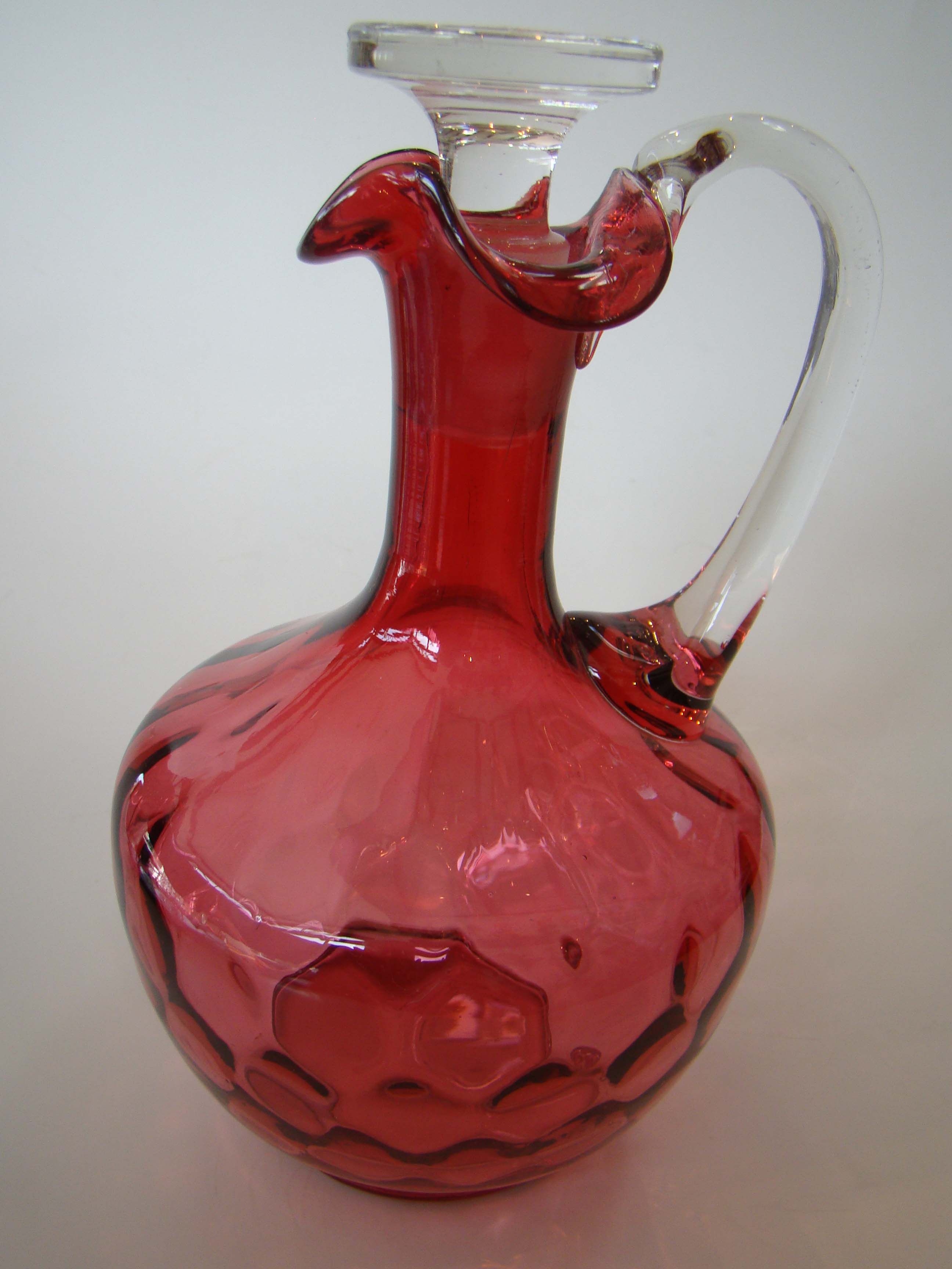 click to view detailed description of A beautiful vintage cranberry glass decanter