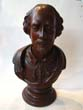 click to view detailed description of A 19th century carved bust of William Shakespeare