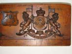click to view detailed description of An 18th century incised carved fruitwood composition mold bearing the arms and crest of the Berkeley family dated 1754.