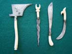 click to view detailed description of A group of four 19th century miniature steel bladed weapons with bone handles