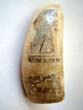 click to view detailed description of A 19th century scrimshawed polycome decorated whales tooth featuring LADY LIBERTY, UNION and a family or regimental crest circa 1860.
