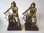 click to view detailed description of A fabulous pair of bronze and brass finished Gloucester Fisherman bookends