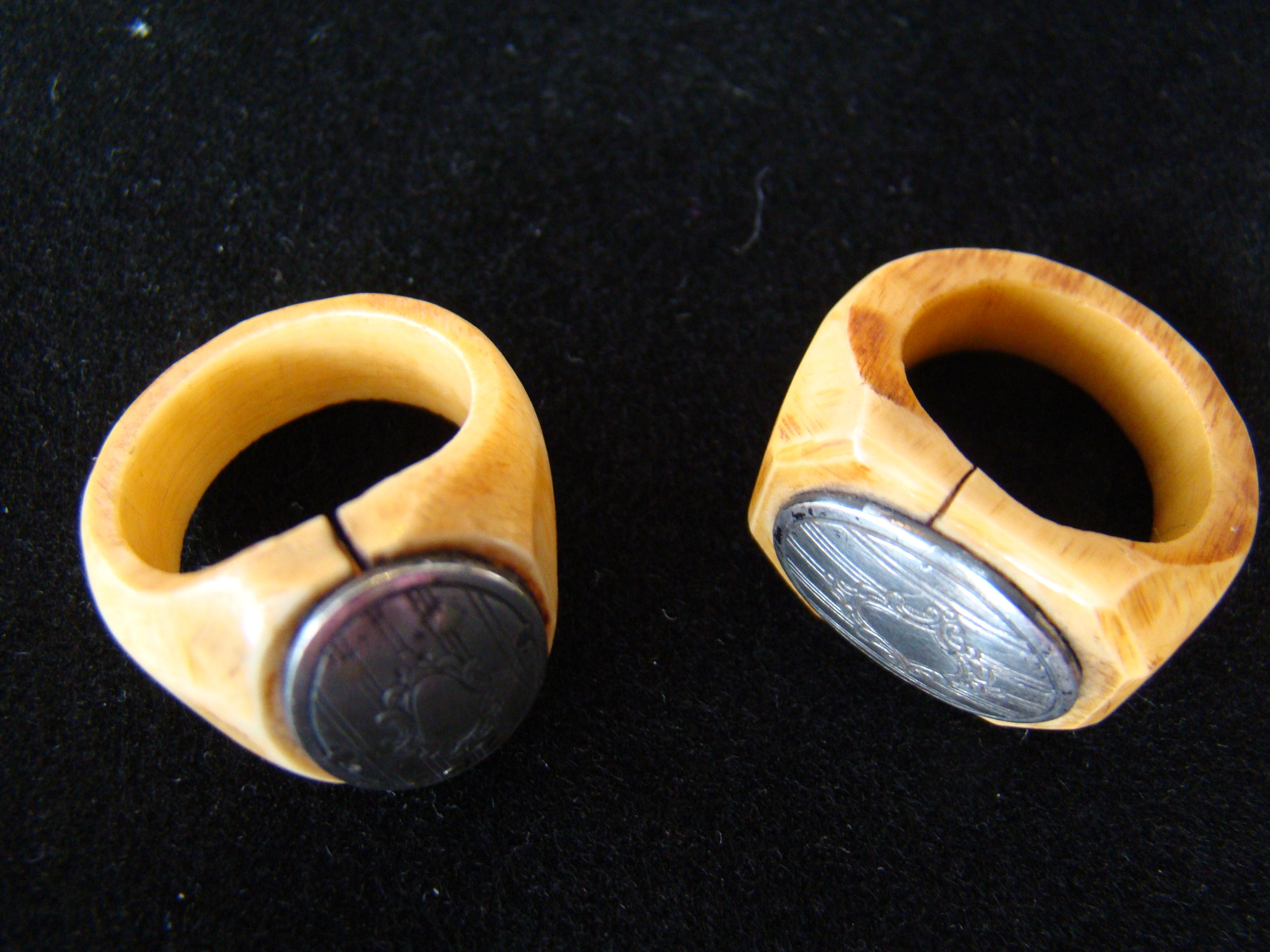 click to view detailed description of A RARE pair of 19th century  sailor-carved whale ivory signet style rings with engraved silver inset