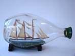 click to view detailed description of An American ship in a bottle circa 1940-1950