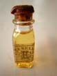 click to view detailed description of A fine and rare unopened bottle of whale oil circa 1875 distributed by Ezra Kelley (1798-1895) of New Bedford, Mass.