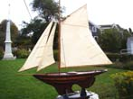 click to view detailed description of A large plank-on frame NANTUCKET Sloop Pond Boat from the 1940s