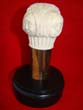 click to view detailed description of A rare carved four sided ivory knob from a cane with each side depicting the face of a woman with a different expressions. American circa 1850-1875