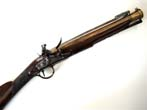click to view detailed description of  An exceptionally fine Early 19th Century English Flintlock Blunderbuss with Spring Bayonet by Joseph and William Richards circa 1808.