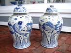 click to view detailed description of An attractive pair of    Chinese Temple Jars in Koi fish motif, 20th century