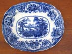 click to view detailed description of A fine and rare early 19th century Flow Blue serving platter in the