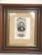 click to view detailed description of A 19th century engraving of President Abraham Lincoln in its original frame circa 1865