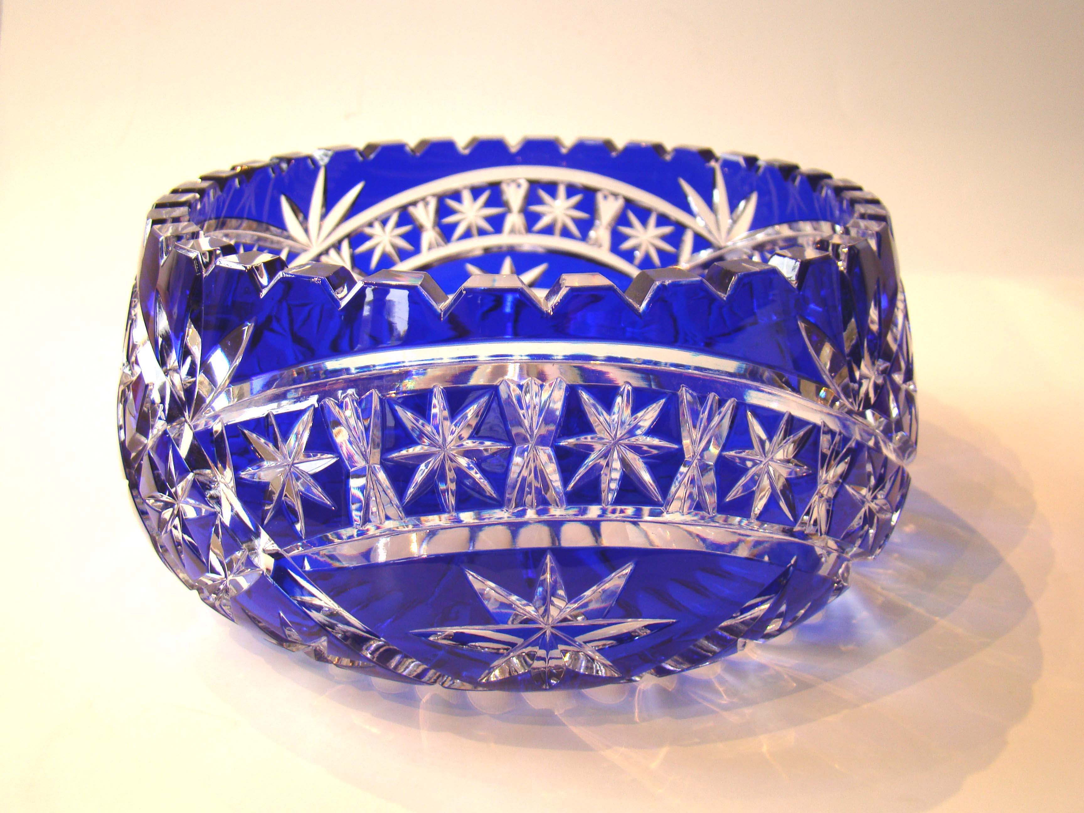 click to view detailed description of A stunningly beautiful cobalt cut to clear glass bowl.