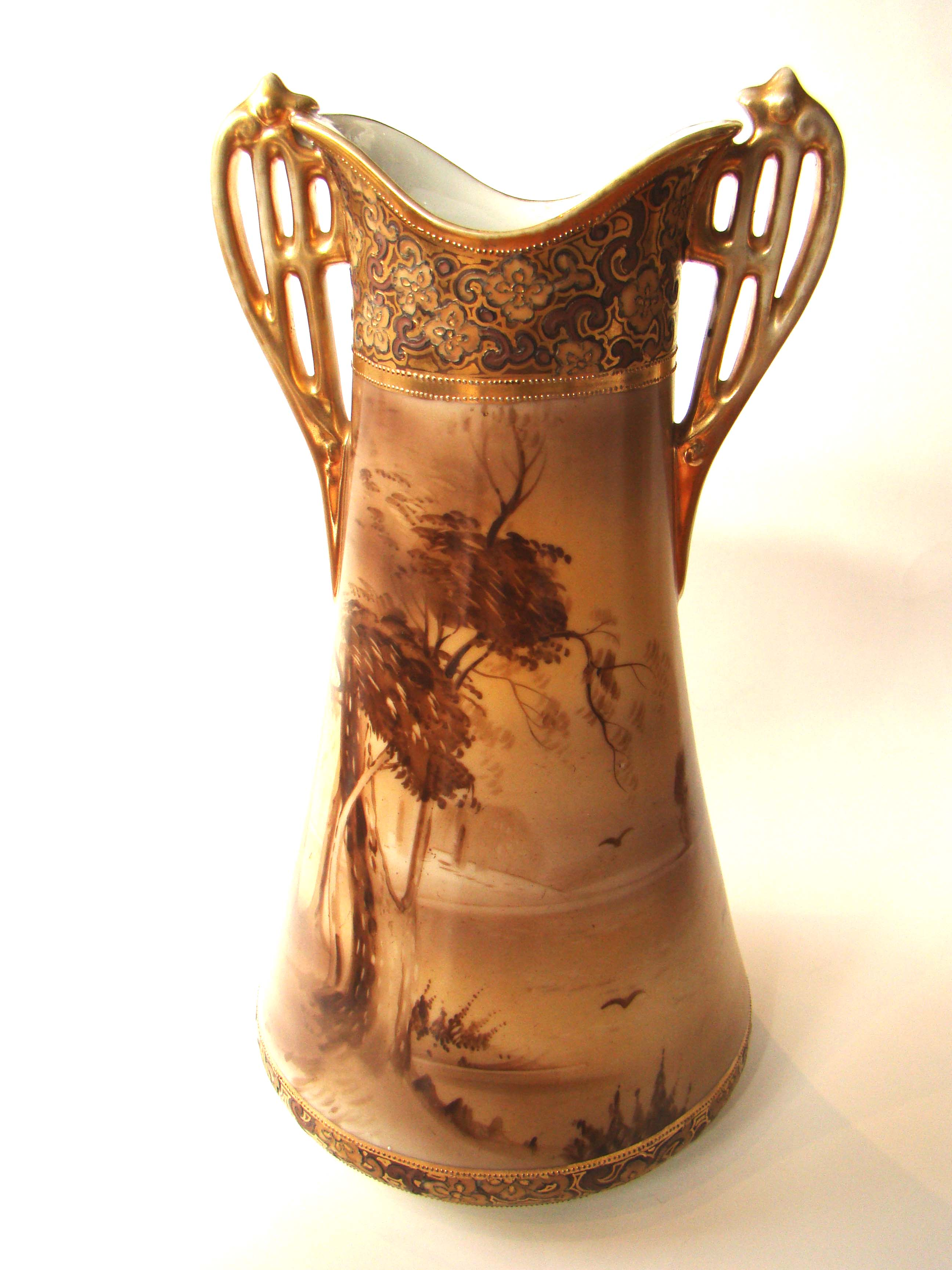 click to view detailed description of A fabulous vintage hand painted NIPPON two handled vase with gilt decoration circa 1900