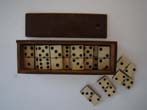 click to view detailed description of A complete set of Civil War era bone and ebony dominoes circa 1860-1870