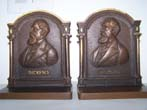 click to view detailed description of A Fine Pair of Antique Bookends by BRADLEY & HUBBARD depicting Charles Dickens circa 1920