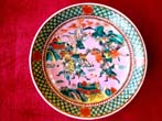 click to view detailed description of A fabulous vintage Chinese 12' enameled plate featuring Warriors on horses