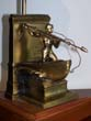 click to view detailed description of A New Bedford Whaling Monument Bookend circa 1950 now forming the base of a lamp