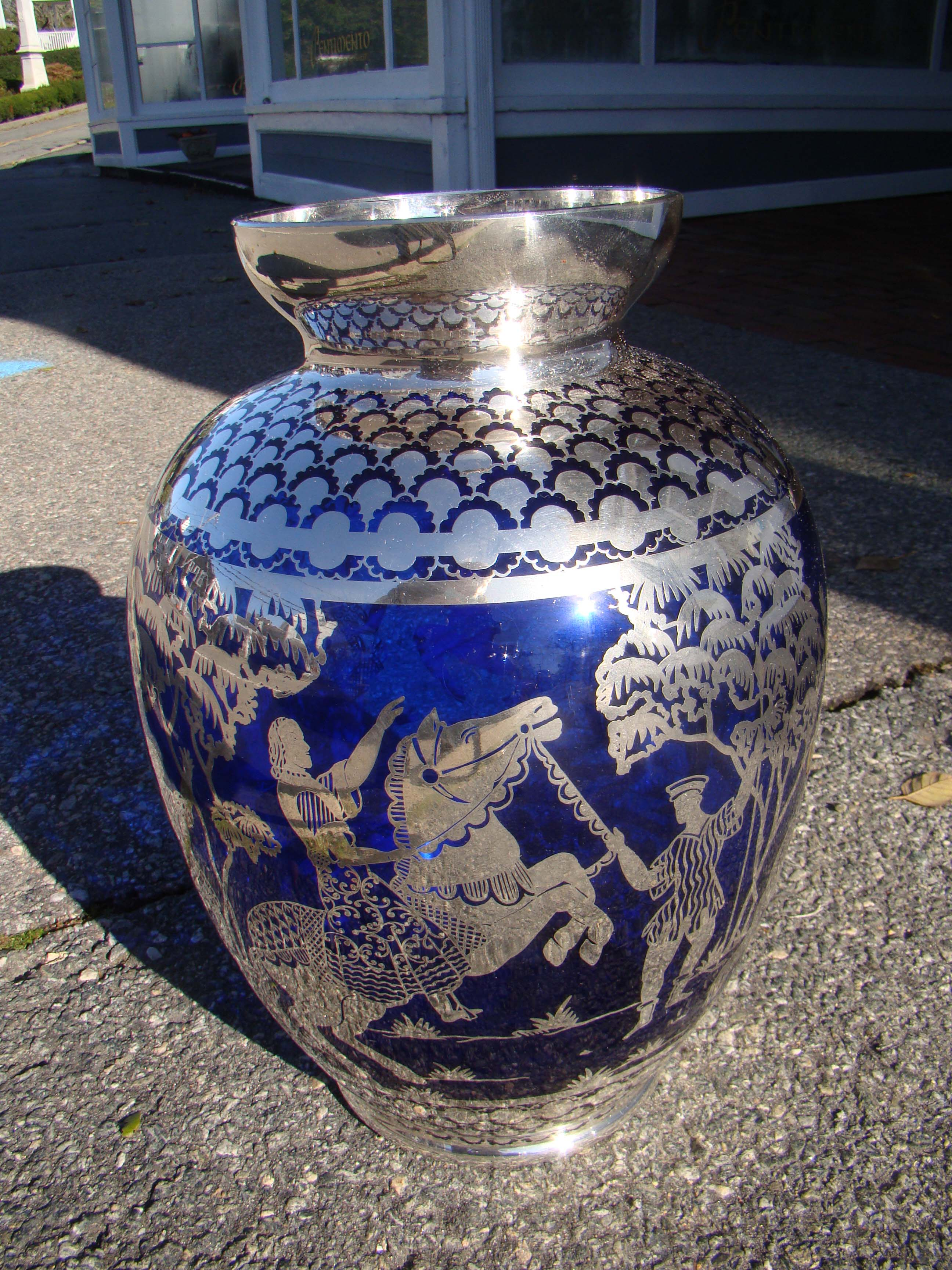 click to view detailed description of A SPECTACULAR vintage cobalt blue with  silver overlay vase depicting