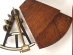 click to view detailed description of An early 19th century ebony framed sextant by Thomas Jones of London