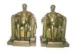 click to view detailed description of A nice pair of Antique Bookends circa 1935 depicting Lincoln 'Sitting in the Chair' at the Lincoln Memorial.